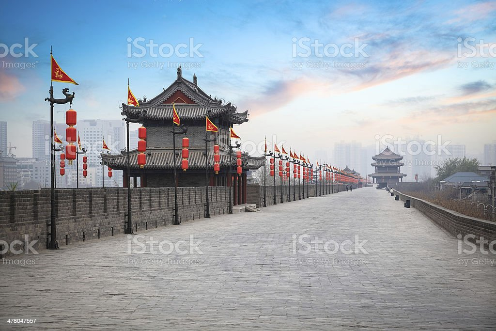xian ancient city wall at dusk stock photo