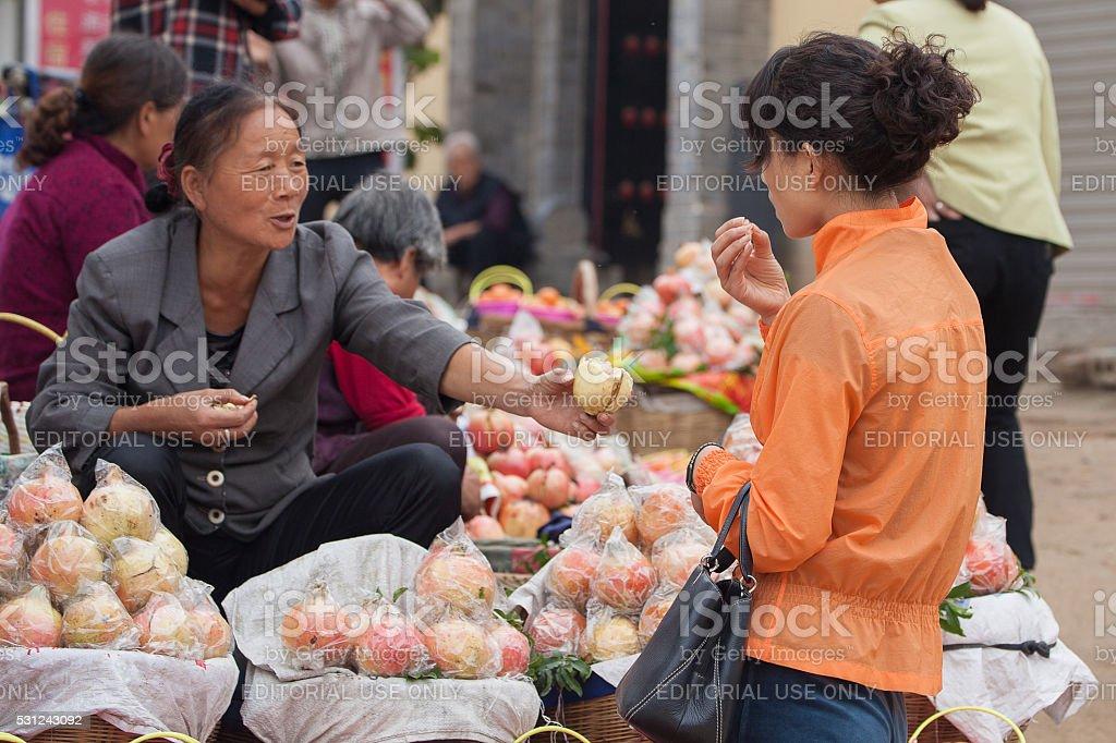 Xi'an Street Vendor Selling Pomegranate. stock photo