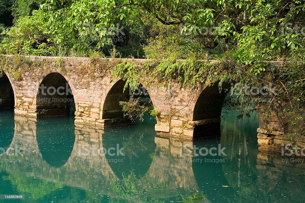 Xiaoqikong Bridge across tranquil river stock photo