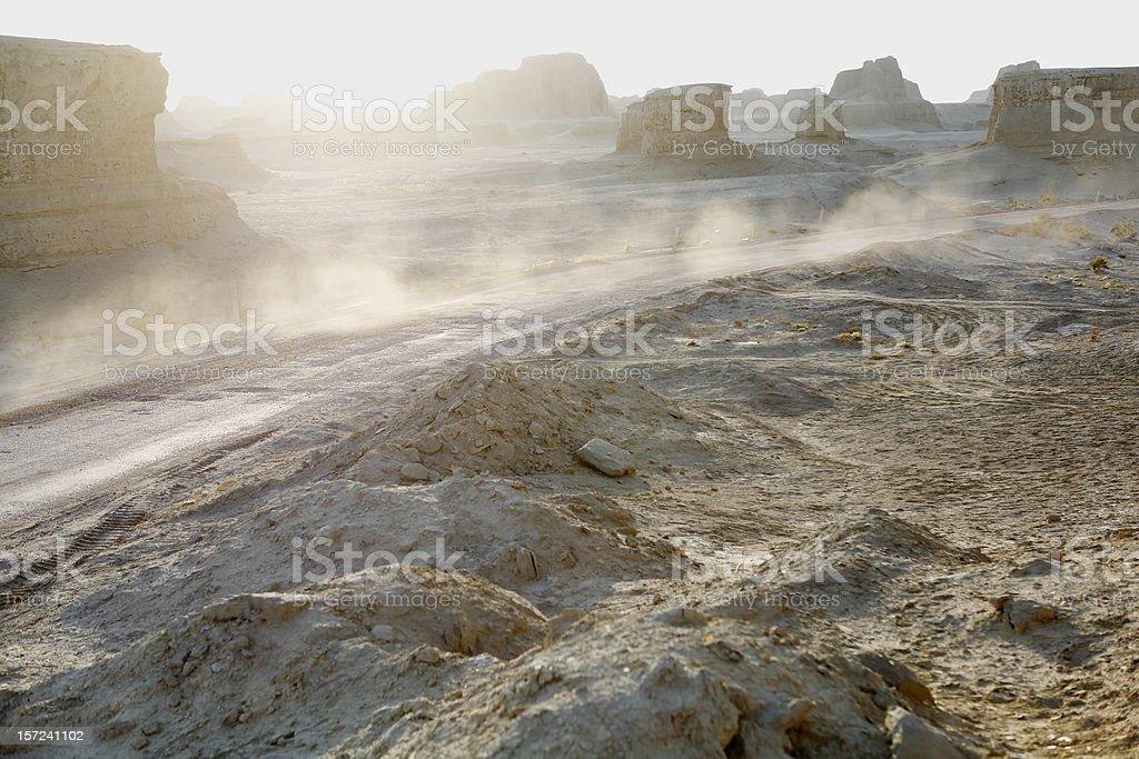 a dirt road runs through the gobi desert in urho, near kalamay,...