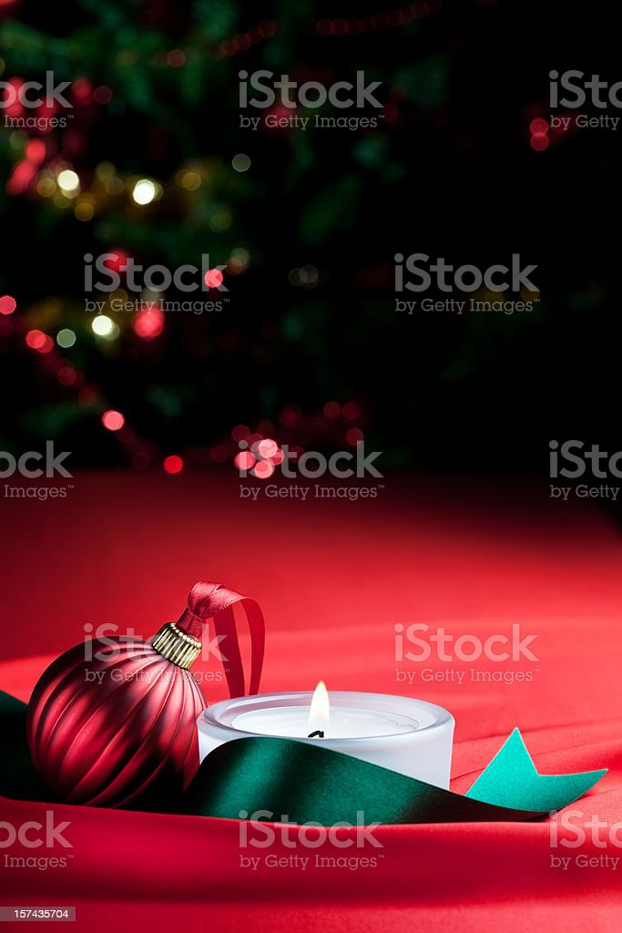 Xmas bauble, candle and defocused lights royalty-free stock photo