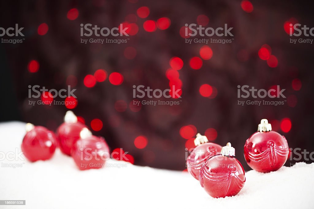Xmas baubles in snow royalty-free stock photo