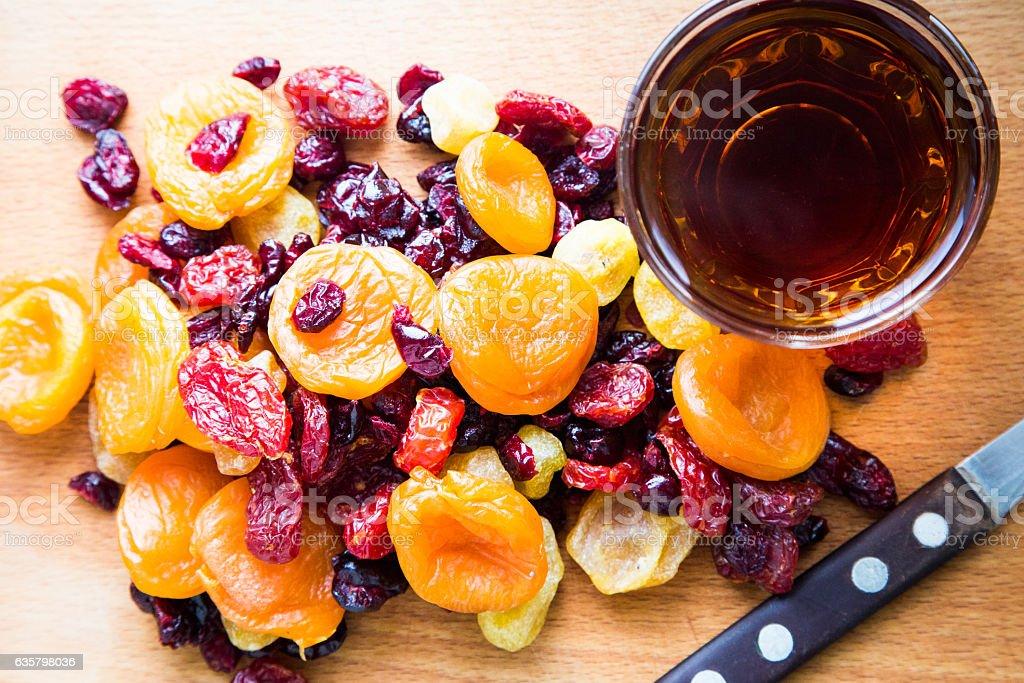 Xmas Cake Mix of soft fruits soaking up added brandy stock photo