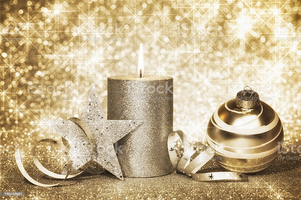 Xmas candle and shining stars stock photo