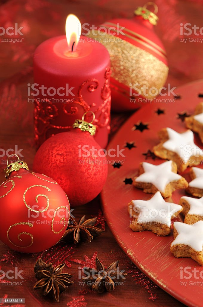 Xmas candle with christmas balls and traditional cookies stock photo