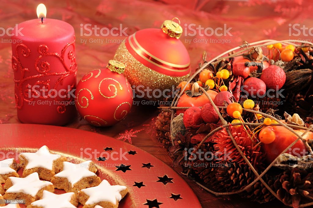 Xmas candle with christmas wreath balls and traditional cookies stock photo