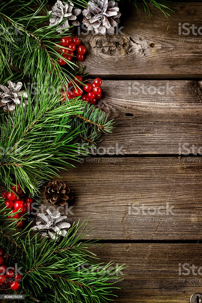 Xmas wreath card  with copyspace on wooden background. stock photo