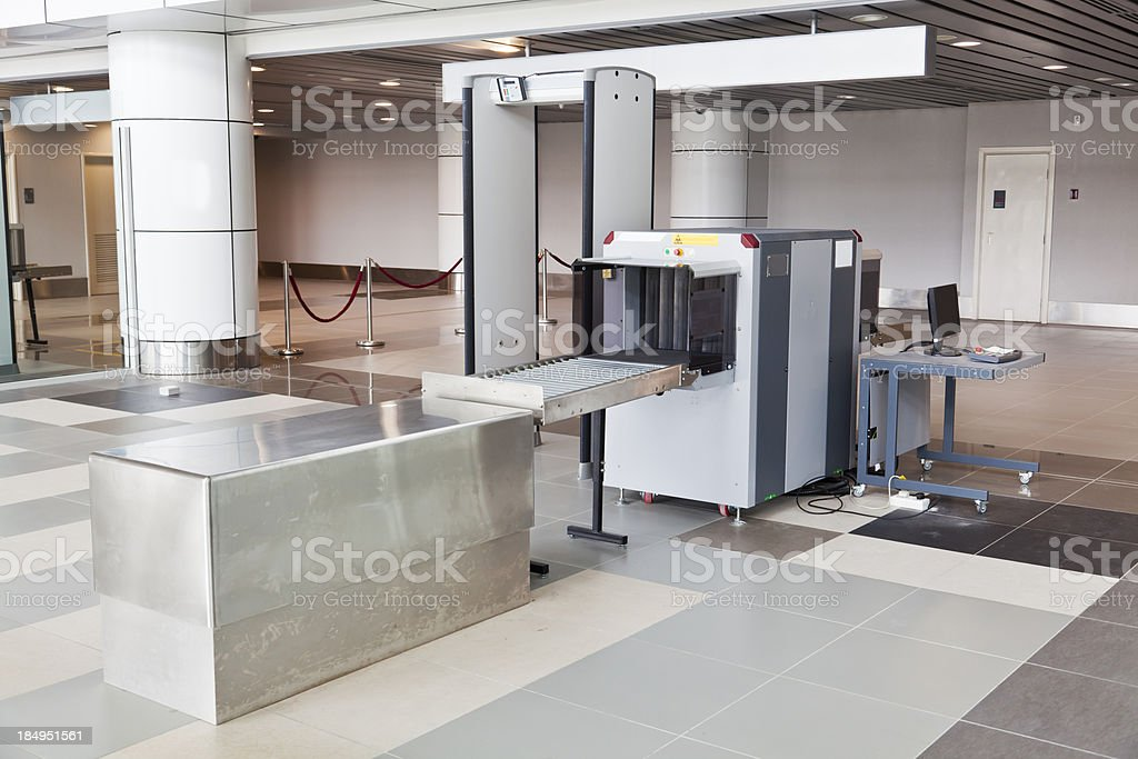 X-ray scanner and metal detector at airport security point stock photo