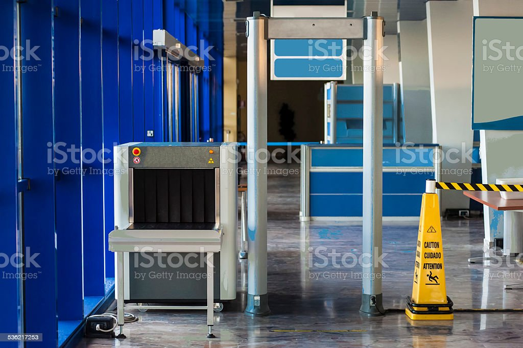 X-ray scanner and metal detector at harbor security point stock photo