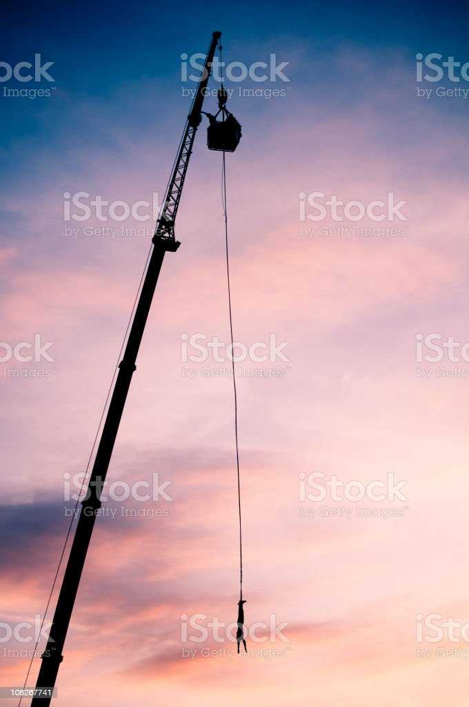 xtreme bungee jumping in sunset stock photo