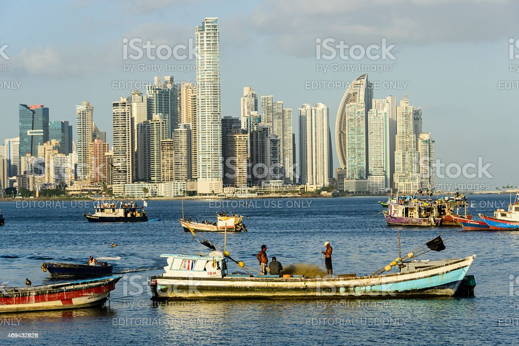 XXXL:Fishermen working on their nets in front of Panama City stock photo