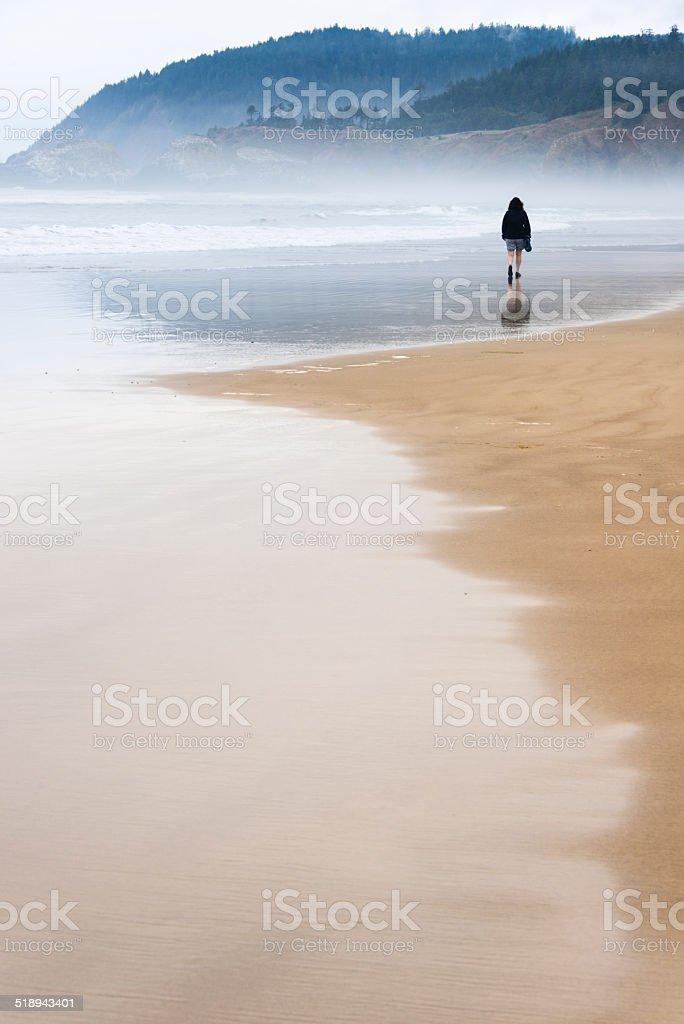 XXXL:Woman walking on the beach stock photo