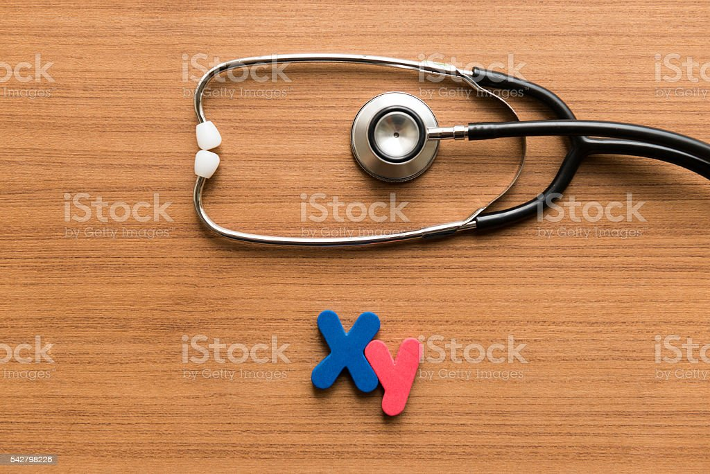xy colorful word with stethoscope stock photo
