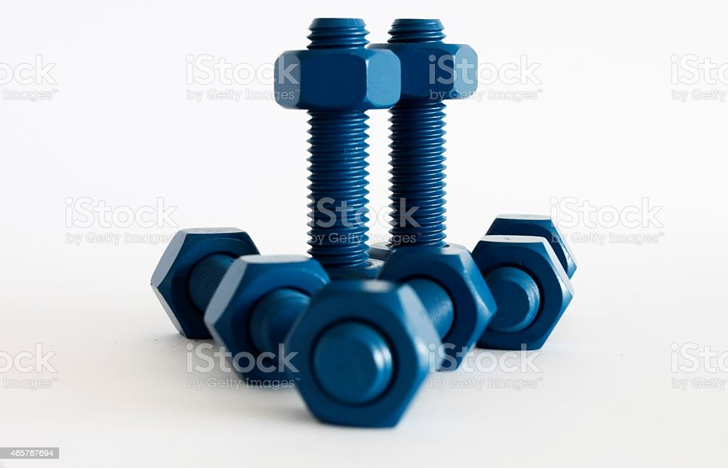 Xylan bolt and nut in blue coated with PTFE stock photo