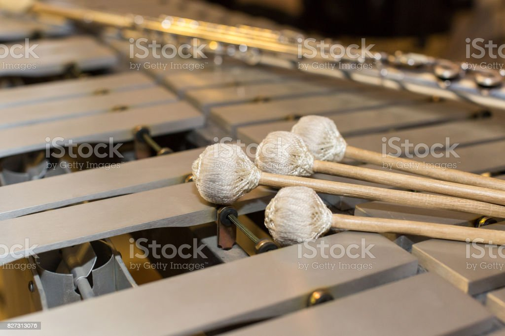 xylophone, music and chromatic instrument concept - closeup on wooden bars with four mallets, glockenspiel, marimba, balafon, semantron, pixiphone, education and orchestra concert usage stock photo