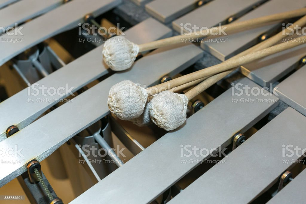 xylophone, musical percussion instruments concept - closeup on wooden beige bars with mallets, glockenspiel, marimba, balafon, semantron, pixiphone, education and orchestra concert usage stock photo