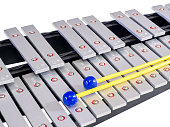 Xylophone with mallets on isolated white background, selective f