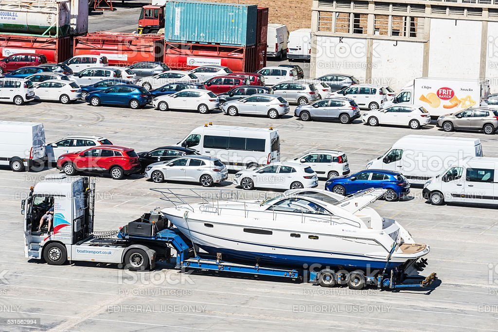 Yacht and cars waiting to shipping stock photo