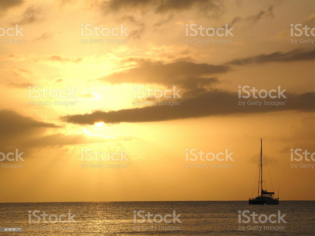 yacht and golden sunset royalty-free stock photo