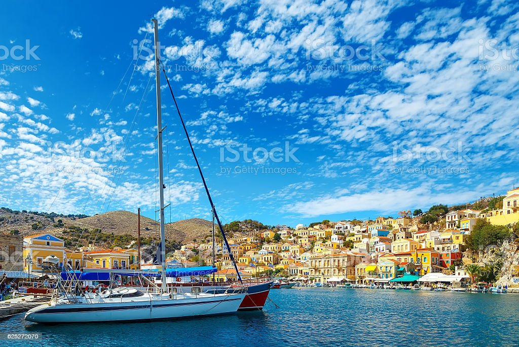 yacht and houses on the symi island, Greece stock photo