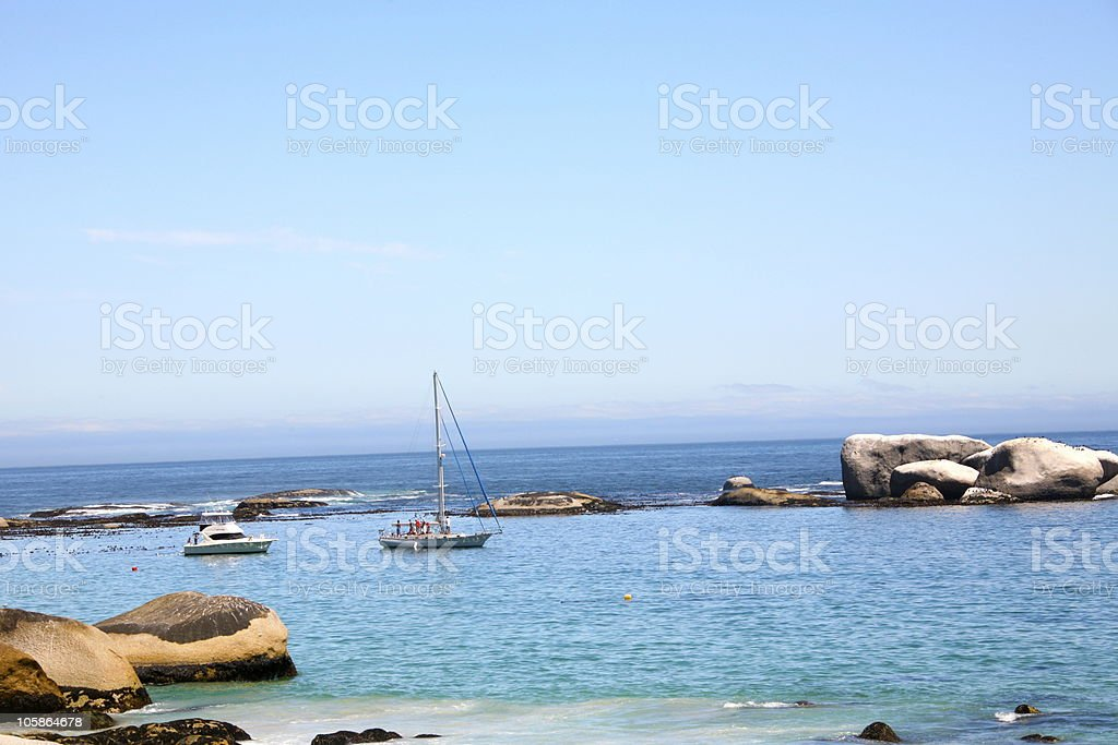Yacht and Motor Boat Moored in Idyllic Turquoise Sea  stock photo