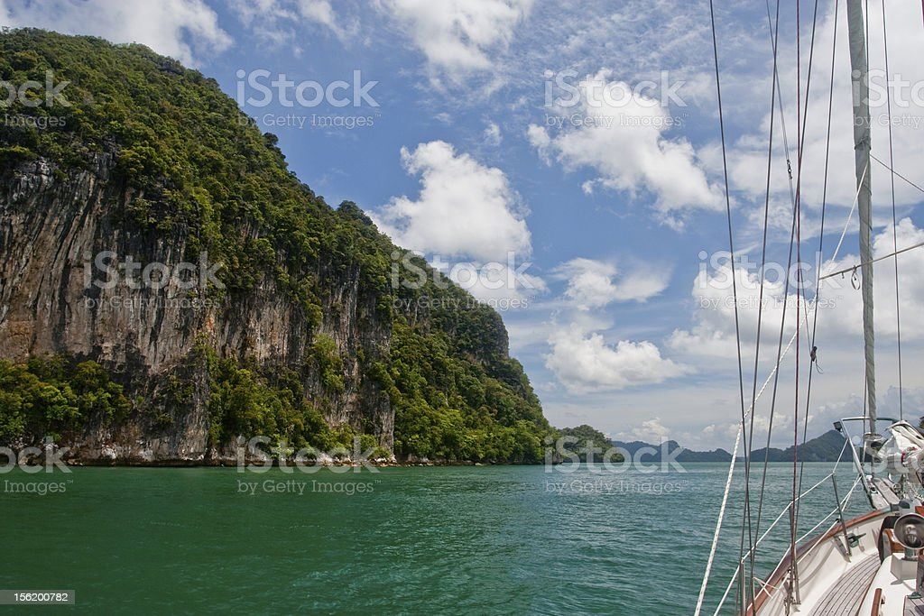 Yacht and rocks royalty-free stock photo