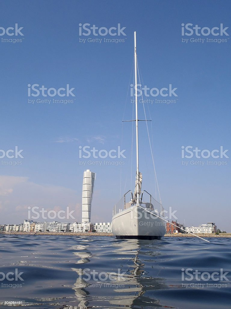 Yacht and Turning Torso in Malmo stock photo