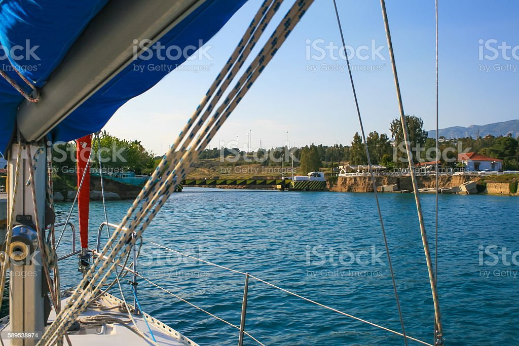 Yacht at entrance gate at Corinth Canal, Saronic Gulf, Greece stock photo