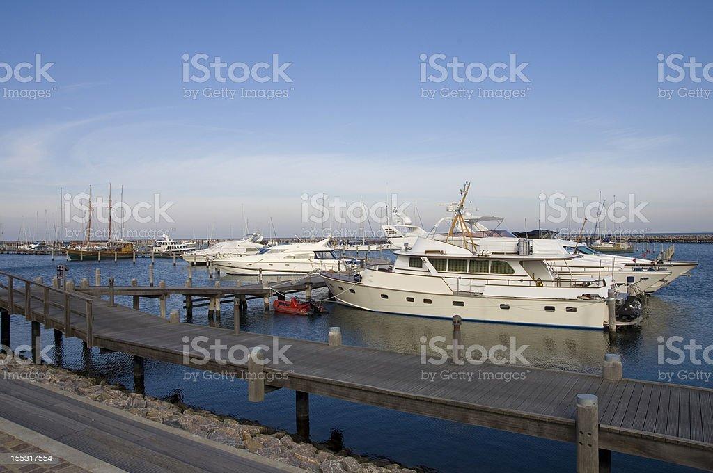 yacht at marina stock photo