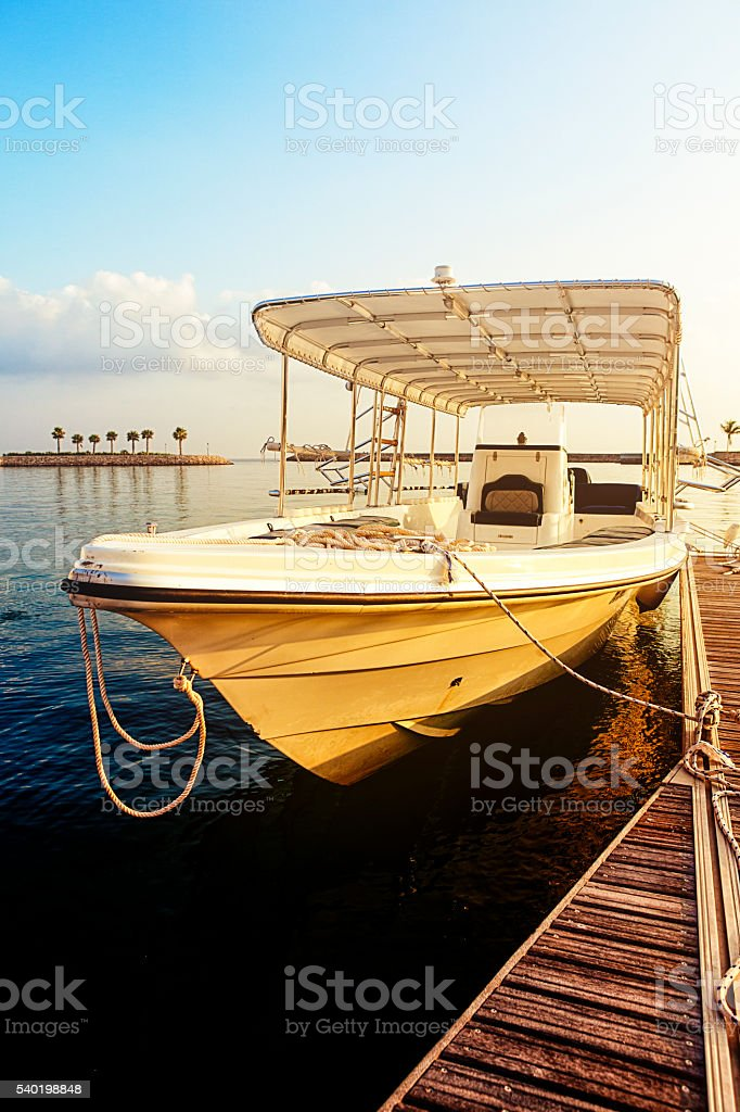 yacht at sunrise, as sifah bay, oman stock photo
