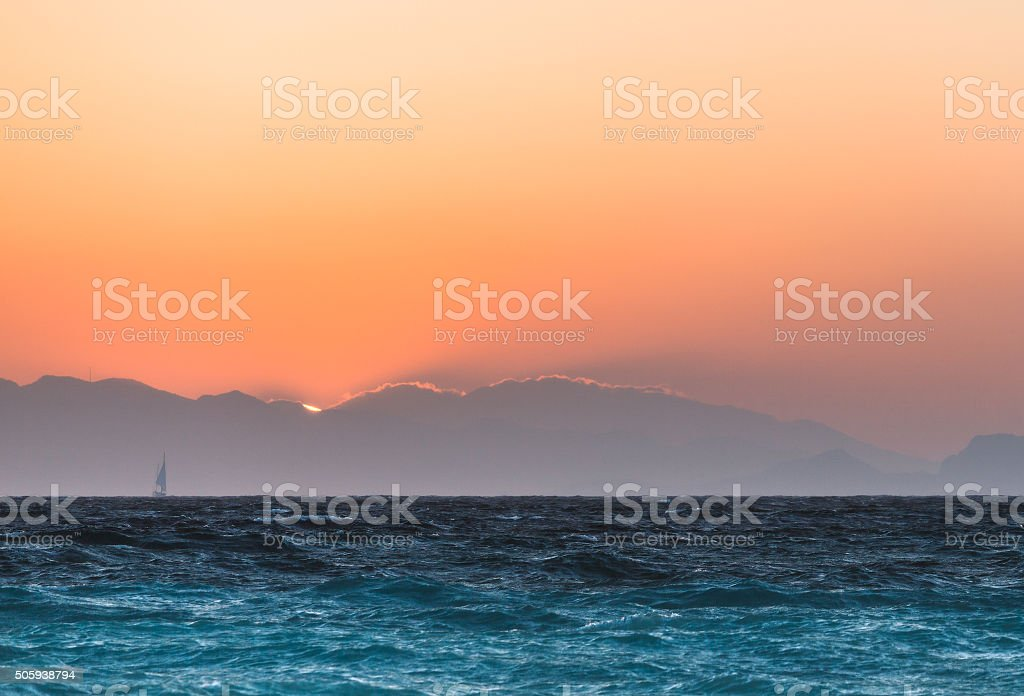Yacht at sunset in the Aegean Sea. Rhodes Island. Greece stock photo