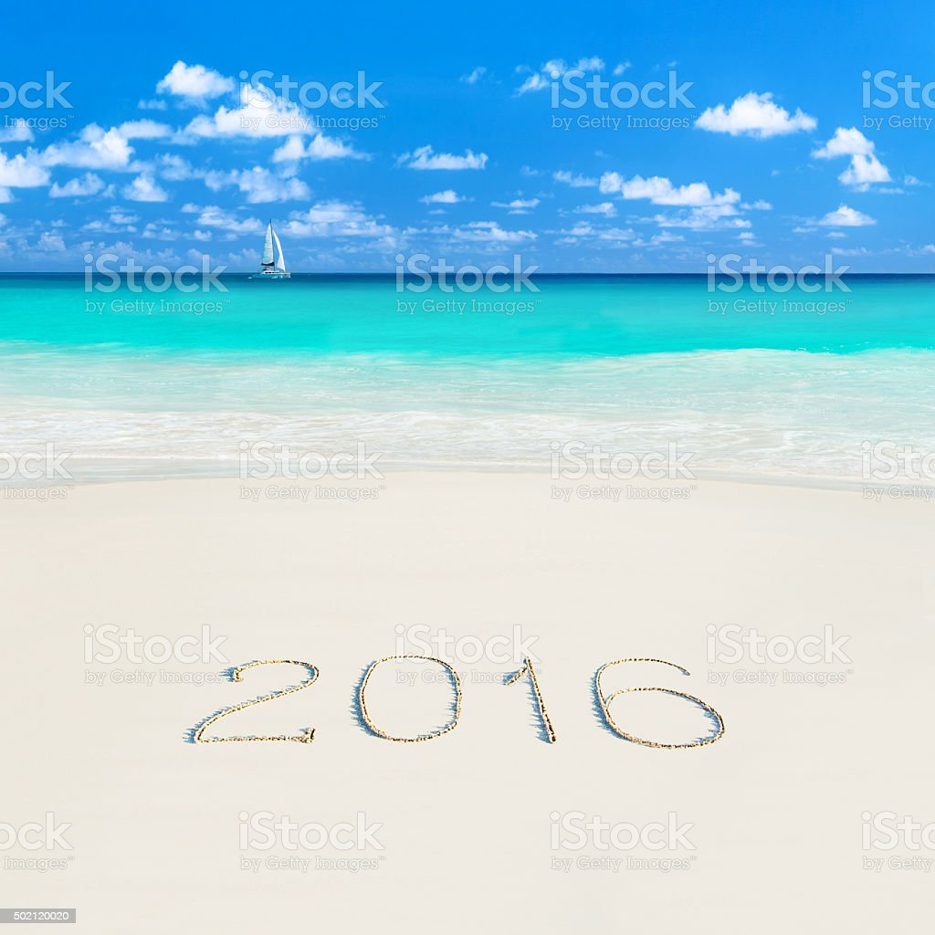 Yacht at tropical sandy beach. Season 2016 Seychelles vacation concept stock photo