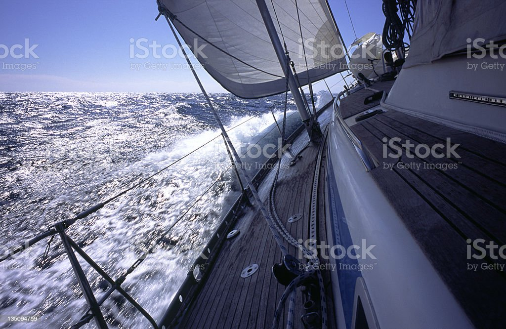 Yacht beats to windward royalty-free stock photo