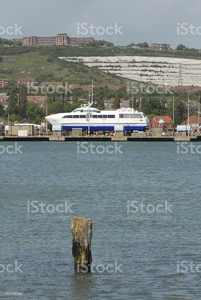 Yacht beneath Portsdown Hill stock photo