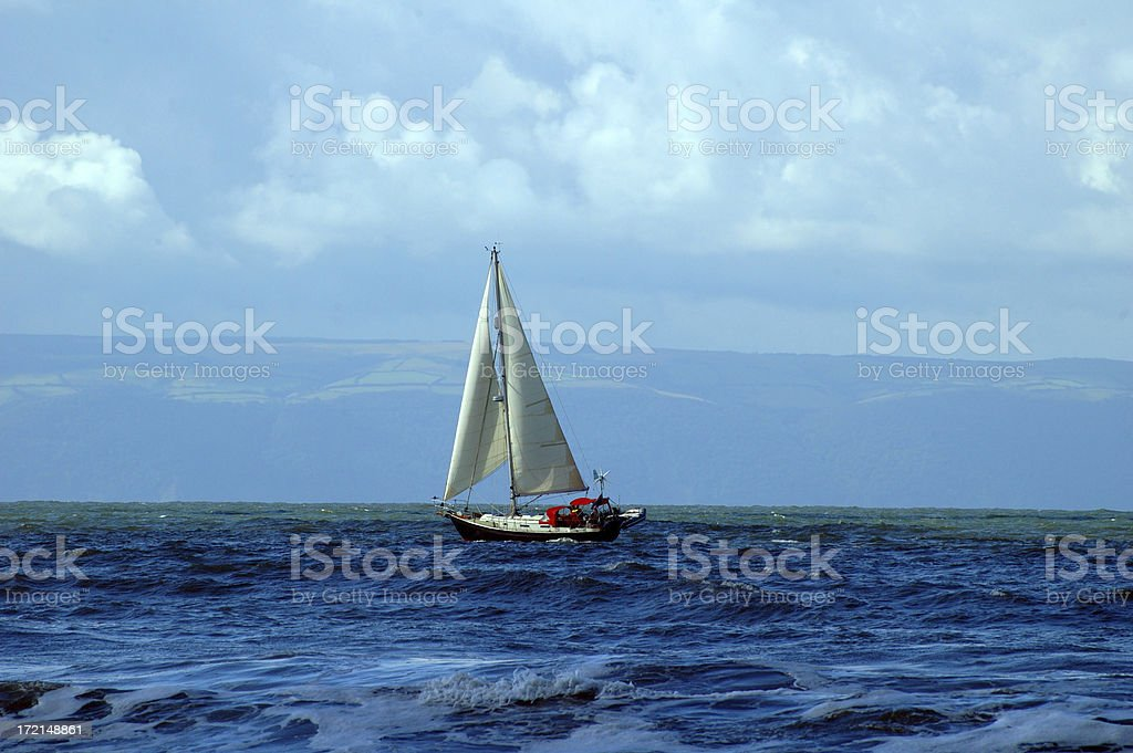 yacht between land royalty-free stock photo