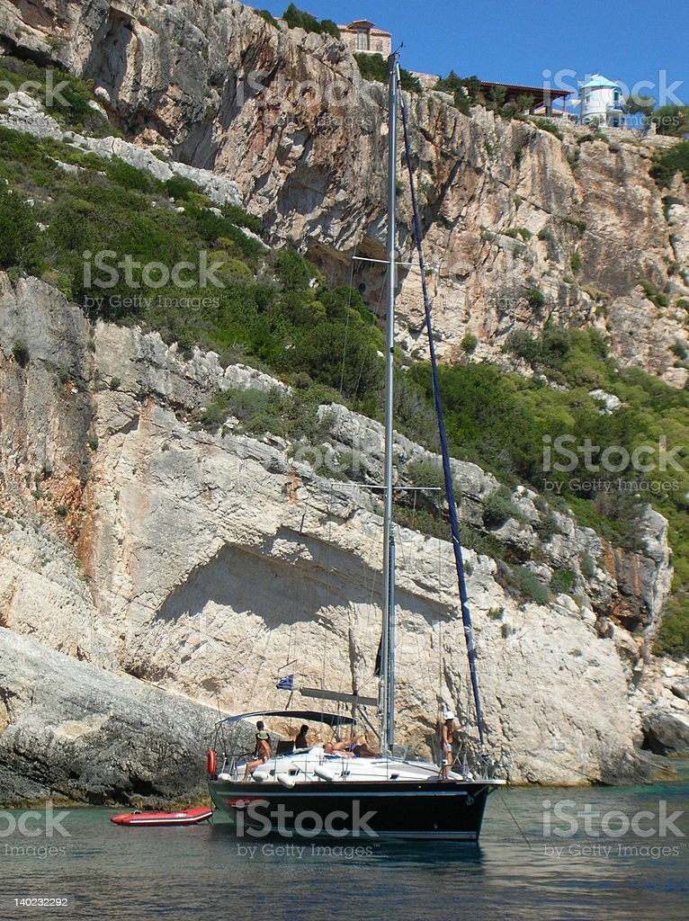 yacht cruising by the rocks in Zante - Greece royalty-free stock photo