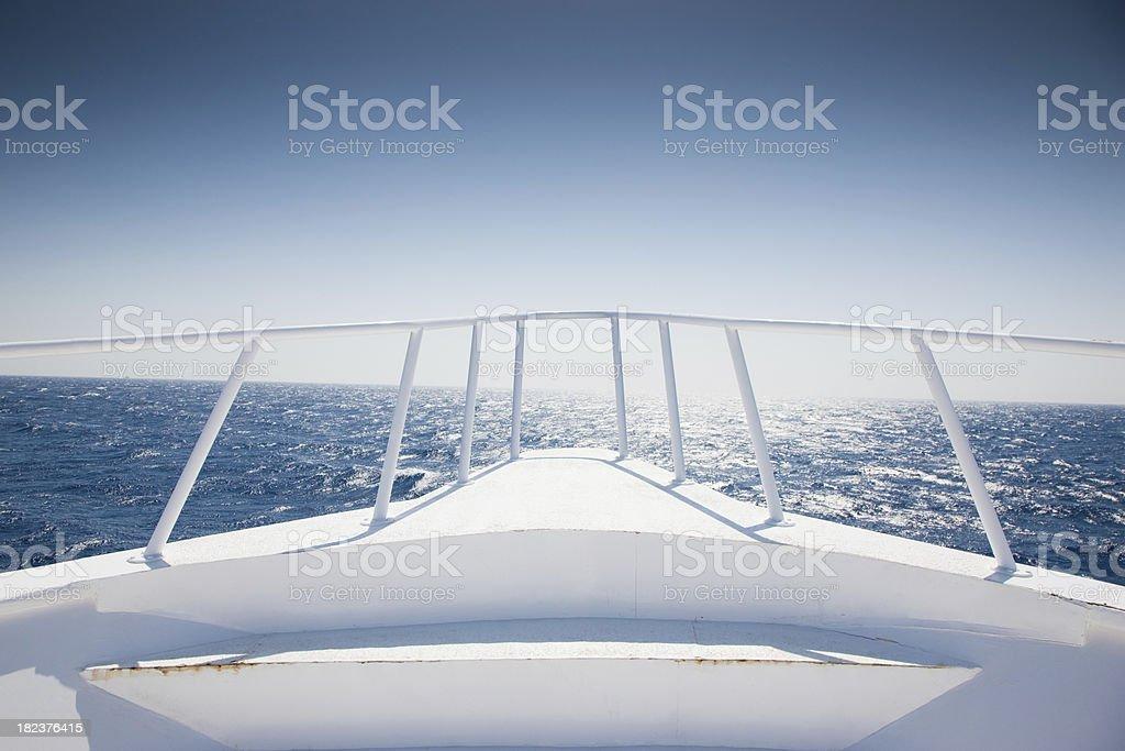 Yacht cruising into open water stock photo