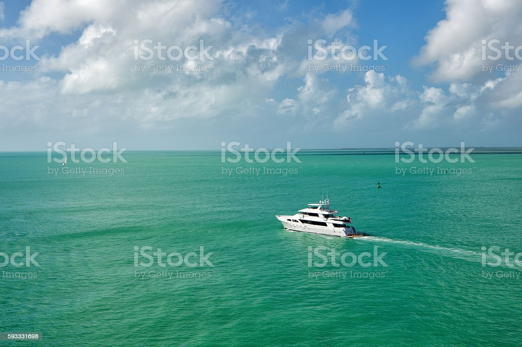 Yacht floating on green water stock photo