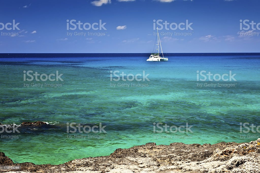 Yacht floats just offshore in the Grand Cayman Islands stock photo
