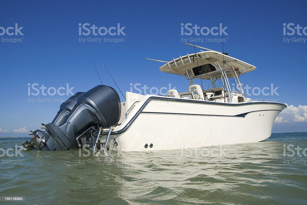 yacht ideal for fishing on ocean under blus sky stock photo