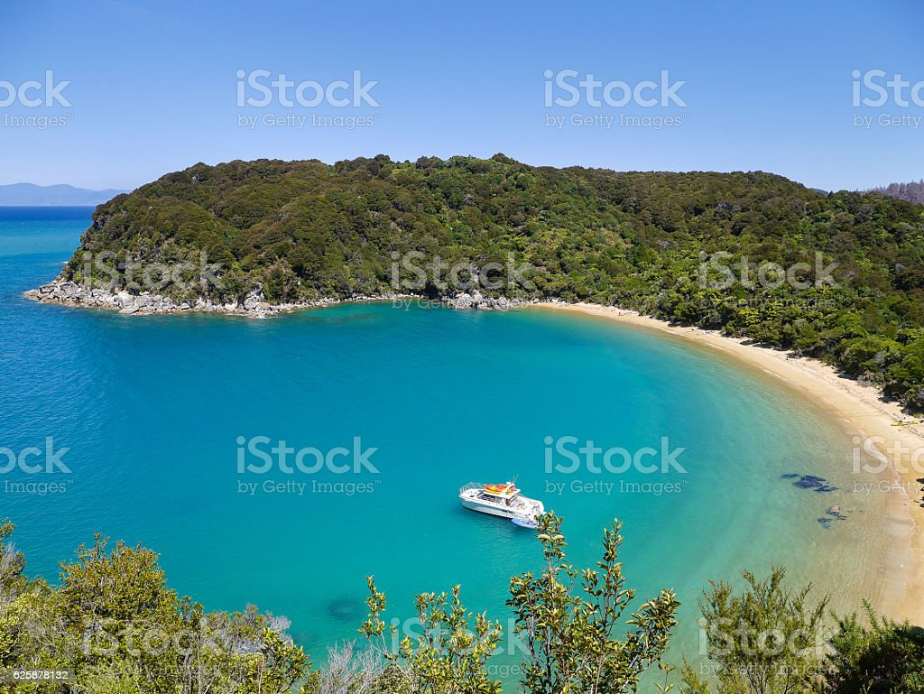 Yacht in a bay of New Zealand stock photo