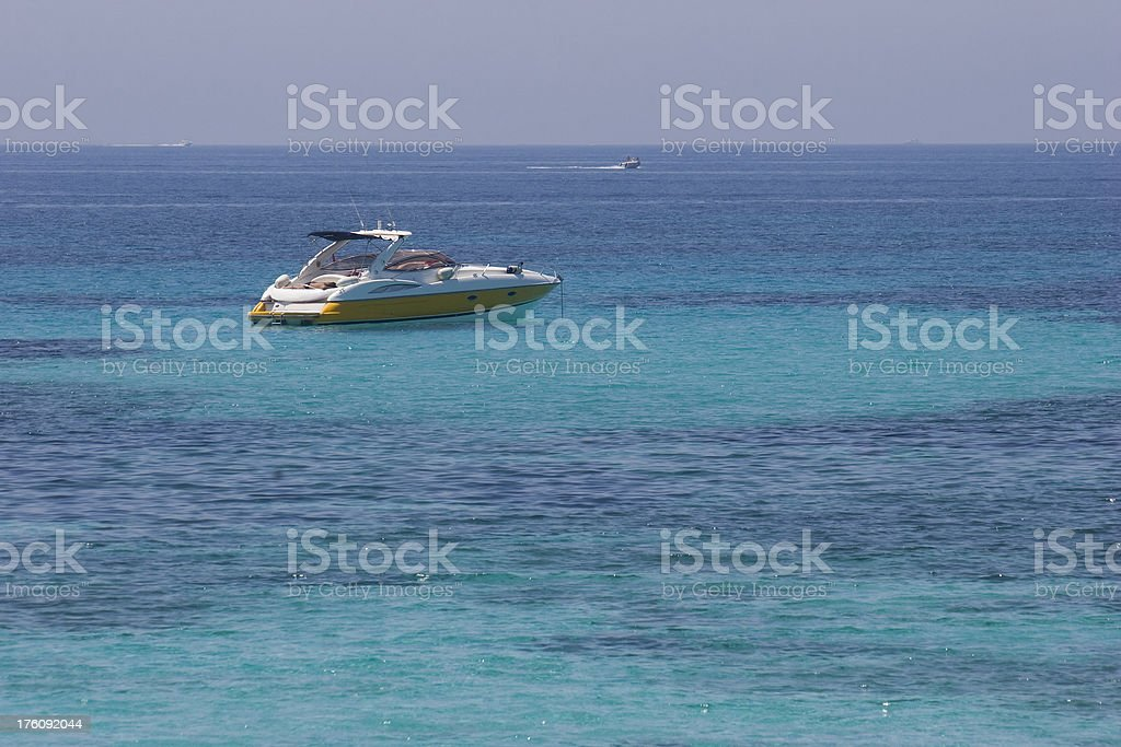 yacht in emerald sea royalty-free stock photo