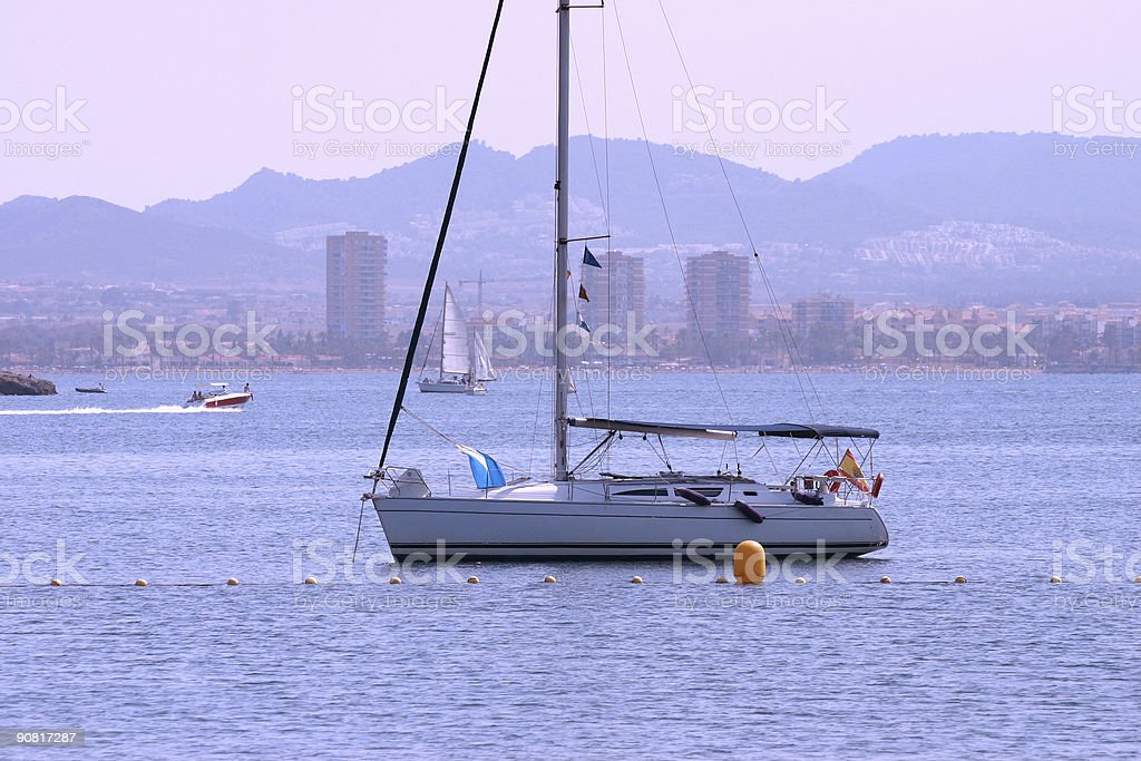 Yacht in Mar Menor Bay under a red sky stock photo