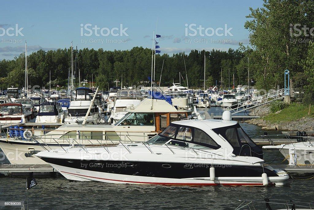 Yacht in marina stock photo
