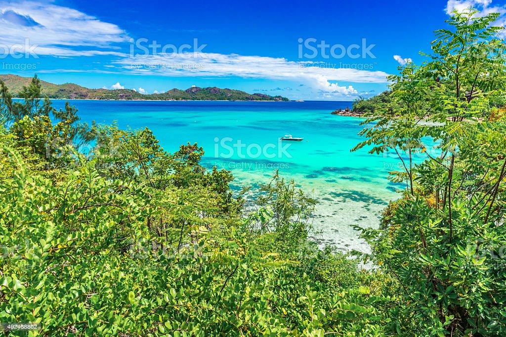 Yacht in paradise bay stock photo