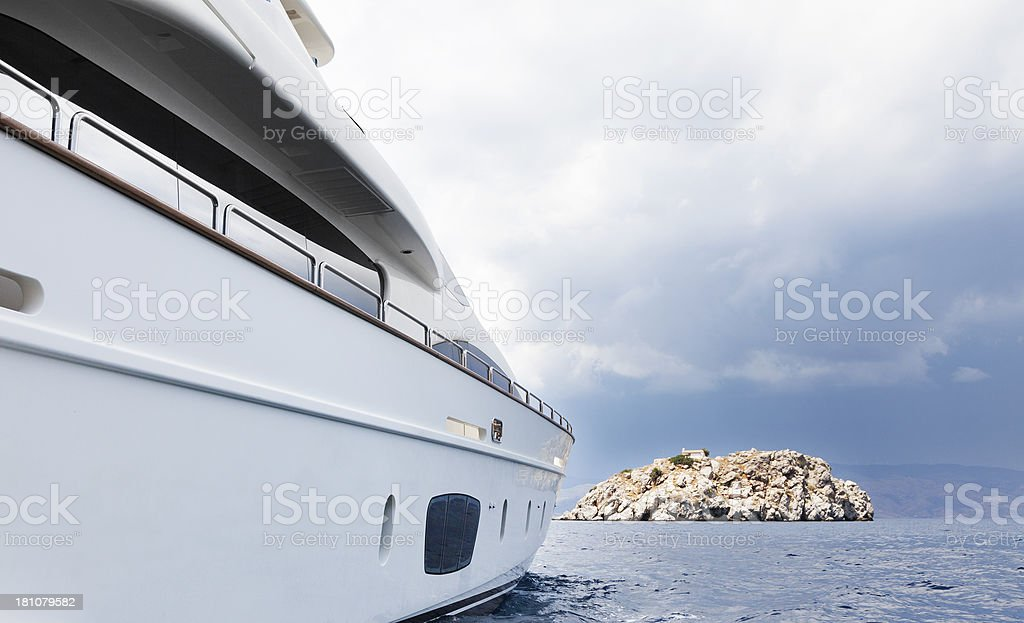 Yacht in the islands. Summer. Moody Sky. royalty-free stock photo