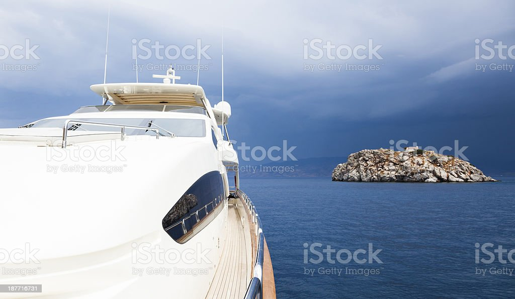 Yacht in the islands. Summer. Moody Sky. Stormy Weather. royalty-free stock photo
