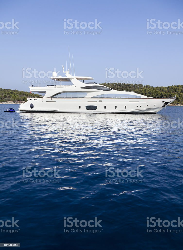 Yacht in the Islands. Summer. royalty-free stock photo