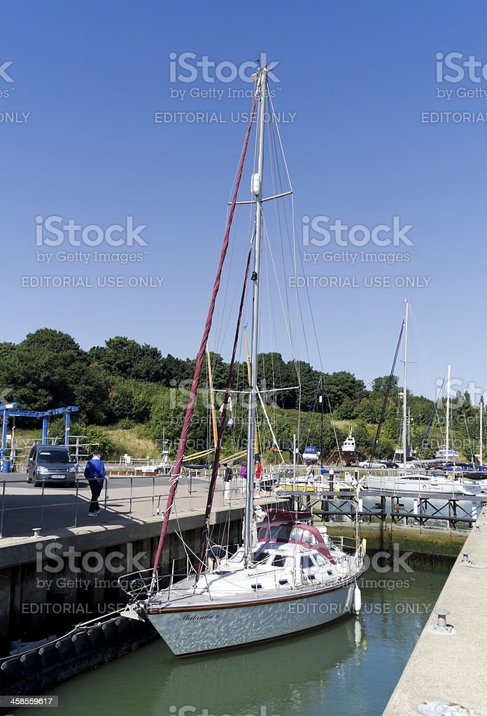 Yacht in the lock at Shotley Marina royalty-free stock photo
