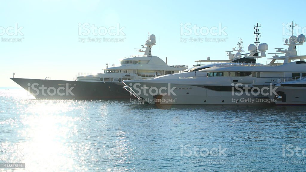 yacht in the port of mykonos stock photo